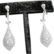 Pretty vintage diamond filagree dangle earrings set in platinum and 14k yellow gold