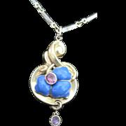 Victorian 18k yellow gold blue enamel flower pendant bezel set with pink garnets on a gold fil