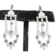A Pair of 18k white gold sapphire and diamond dangling Art Deco period earrings. 108 diamonds