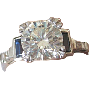 Outstanding vintage Platinum  1.48 ct VVS1 Diamond ring with sapphire and diamond baguettes ..