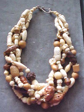 Four strand custom choker necklace made with organics and plastic