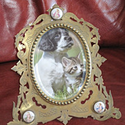 Edwardian Brass and painted cherub picture frame by J. Batson
