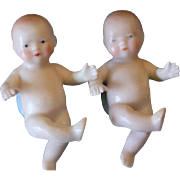 SALE Reduced price!!  Sweetest pair of Vintage porcelain bisque  Bye lo babies  Salt and Peppe