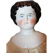 """19"""" tall German china head, flat top, molded curls with center part.  shoulderhead doll,"""