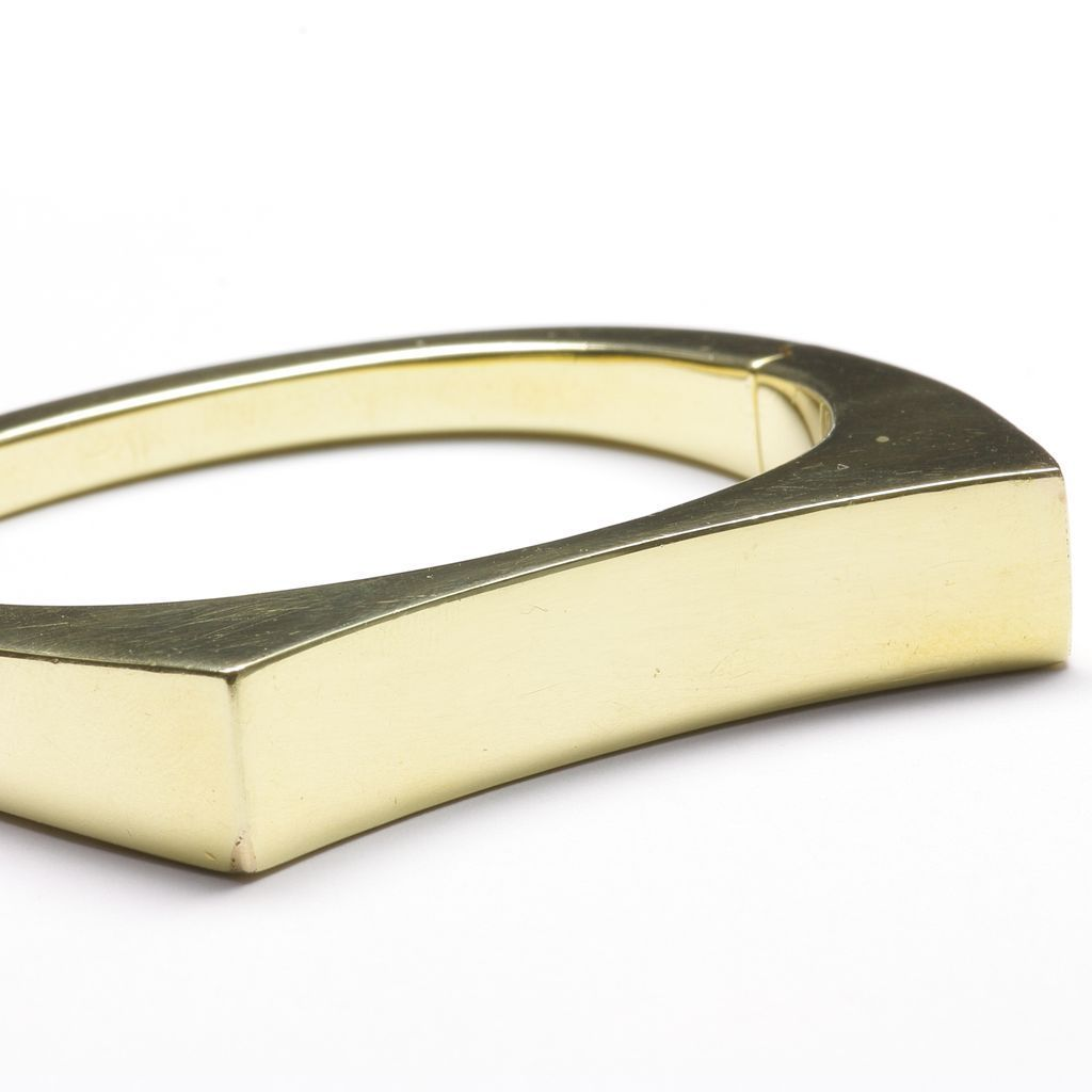 14 karat yellow gold bangle bracelet with concave top c