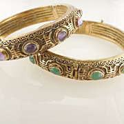 Set Of Two Gold Colored Silver Oval Green And Purple Stones Hinged Bangle Bracelets