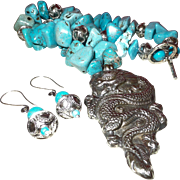 Hand Strung Natural Turquoise with a Dragon Pendant from Tibet
