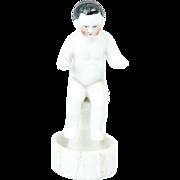 "1910s German Bisque Tiny Frozen Charlotte Sitting on a Pedestal 2 3/4"""