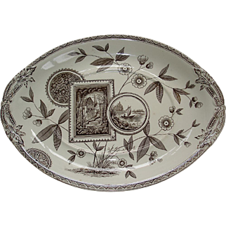 Perak platter: Cartouches with rural cottage, man in sailboat,pond
