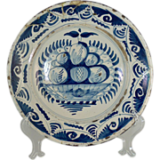 SOLD A large 18th century Delft blue and white charger decorated in the 'boerendelftsch '