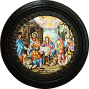A 17th century painted Limoges enamel roundel of the Nativity, circa 1670.
