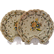 A pair of mid 18th century Talavera majolica scalloped shaped barber's bowls, Talavera de la