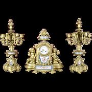 Antique French Gilded bronze figural sevres porcelain three piece mantel clock graniture, c ..