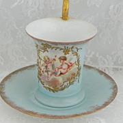 SOLD German Cupid Cup & Saucer