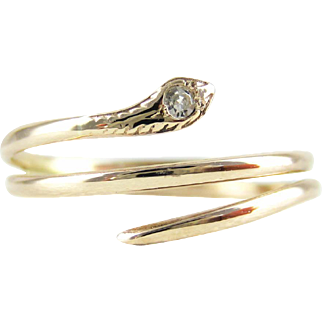Antique Coiled Snake Ring with Diamond Inset Head, Serpent 9 Carat Rose Gold Ring. Circa 1900s.