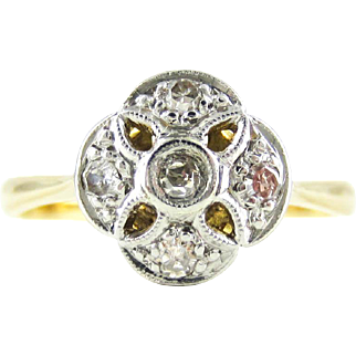Diamond Engagement Ring, Vintage Floral Shape Diamond Cluster Ring with Pierced Design in 18 Carat Gold & Platinum, Circa 1920s.