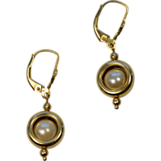 14 Karat Yellow Gold Circle and Enclosed Pearl Earrings