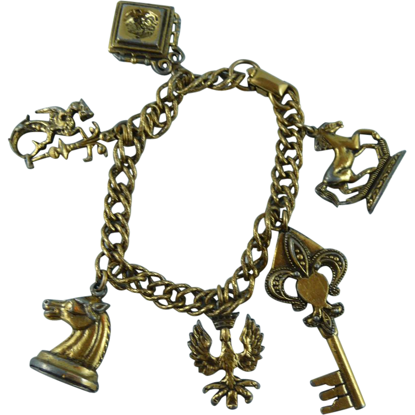 vintage coro charm bracelet from hiptobeold on ruby