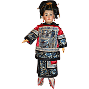 Chinese  Simon et halbig doll, with an elaborated outfit, a wonderful piece