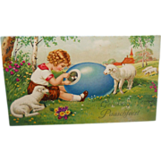 SOLD Easter Postcard~Child Looking into Large Egg Surrounded by Lambs