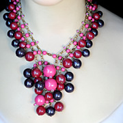 Signed Miriam Haskell pink, wine-colored festoon necklace with beads