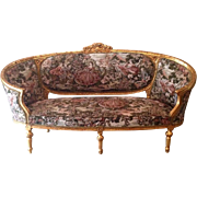 An old French sofa/settee made in 1880 in Louis XVI style
