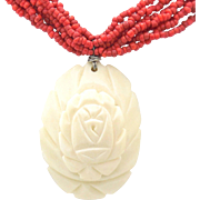 Vintage red coral bead multi-strand necklace with carved rose pendant.