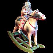 A clown on a rocking horse automaton