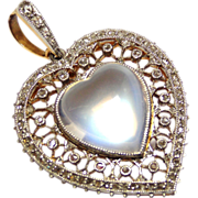 Sensational Antique Edwardian platinum and 18 carat gold moonstone and diamond heart pendant .