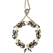 SALE An antique  French laurel leaf circular pendant, pearl and diamond adorned, 1900c.