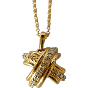 SALE A Tiffany & Co. 18k yellow gold and diamond pendant with chain., 20th century.