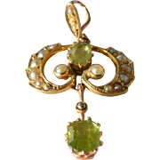 SALE An Edwardian , 1910, gold ( 15ct ) peridot set pendant.