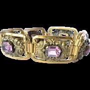 SALE A gilt metal and glass 'amethyst' panel bracelet, revival piece, 1930c.