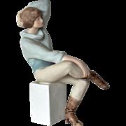 SALE A late vintage Royal Dux, Bohemia  pastel figurine of a seated lady.