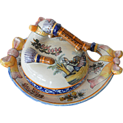 SALE A Henriot Quimper covered faience dish, 'Biniou' ( bagpipe ) motif, 1940c.