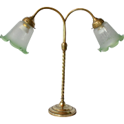 SALE A French brass and glass two branched table lamp, 1910 to 1925.