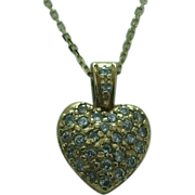 Lady's 14K yellow gold diamond heart pendant and chain