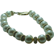 Lady's fine cultured pearl and gold filled bead bracelet