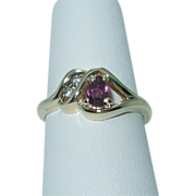 Lady's  ruby and diamond 14K yellow gold ring
