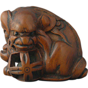 Signed Meiji Period Japanese Carved Wooden Netsuke in the form of a ShiShi/Lion Dog