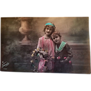 Undated early 20th century postcard with siblings