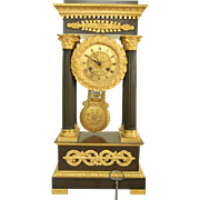 Empire clock Patinated And Ormoulu Bronze - France circa 1830 - Signature of Leroy in Paris