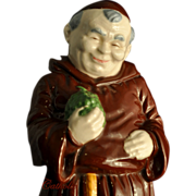 Figure of a Monk Holding Green Grapes