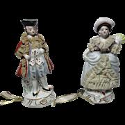 A Pair,COLONIAL Man & Woman Porcelain TAPE MEASURES with lace  detail ;  Antique c1900
