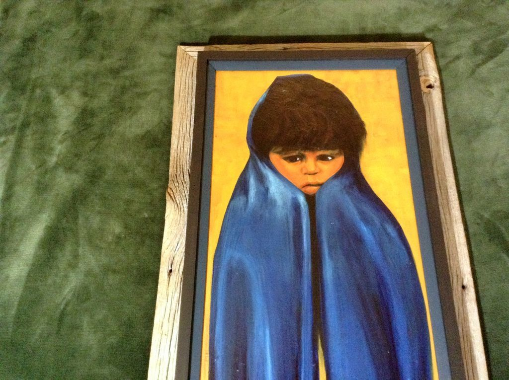 Big Sad Eyed Native American Indian Boy In A Blue Blanket