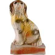 Antique Primitive Chalk Dog Figurine Staffordshire Spaniel on Book Sitting on Hind With Head .