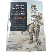 1st edition: Firearms, Traps, & Tools of the Mountain Men by Russell