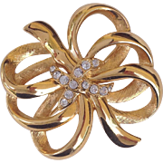 Signed Monet Gold-Tone Bow Brooch With Clear Rhinestones
