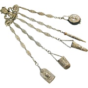An ornate gilt metal sewing chatelaine. English c 1870