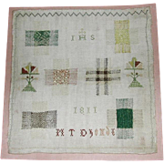 A darning sampler dated 1811 stitched by M T Dhonde